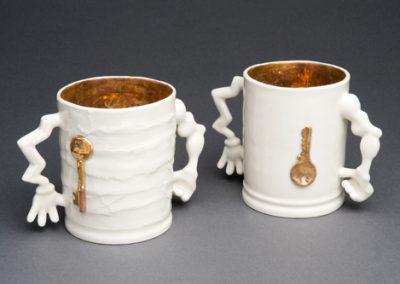 TessaEastman_safe-hands-mug-gold