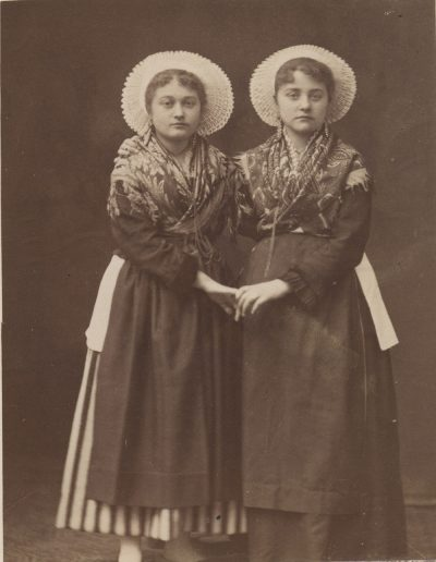 large twins with hats